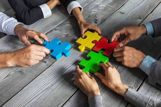 Business Team with Jigsaw Puzzle