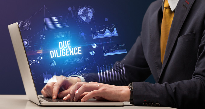 Businessman Due Diligence Typing on Laptop