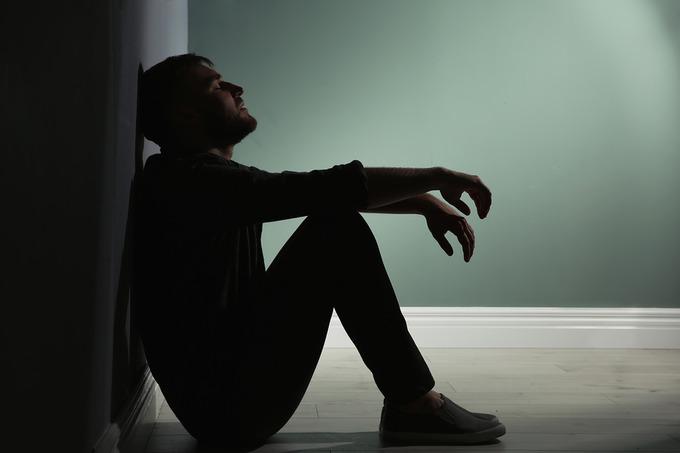Distressed Man Sitting on Floor