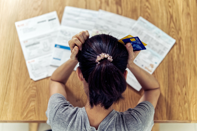 Distressed Woman with Credit Card Bills