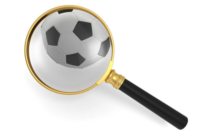 Football and Magnifying Glass