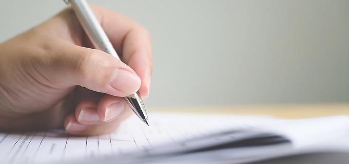 Hand Signing Paperwork