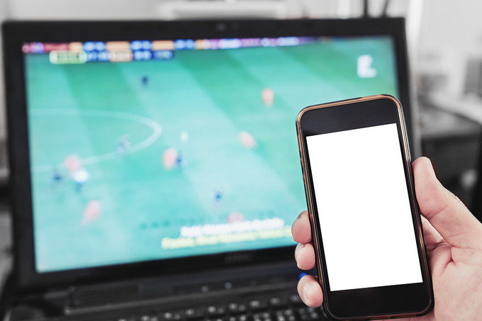 Mobile Phone In Front of Laptop Football