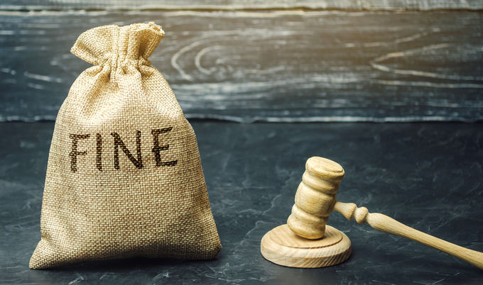 Money Bag with Fine Written On It Next to Gavel