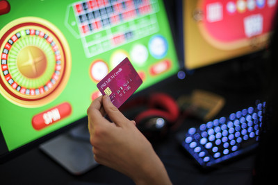 Woman Playing Online Roulette Holding Credit Card