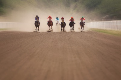 Jockeys on a dirt track