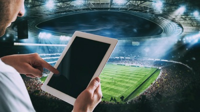 Man with tablet at stadium