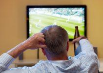 Man Watching Football on TV