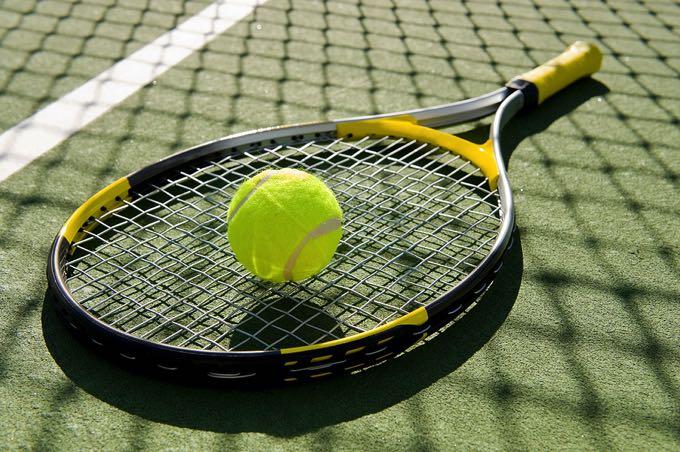 Racket & tennis ball on tennis court